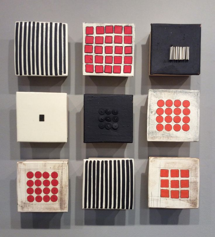 Black and White and Red Nine by Lori Katz. Slab-built stoneware with stoneware inlay, slips, underglaze, glaze and mixed media. Each component is backed on wood and hangs simply on picture hooks from hanging wire across back. Dust or wipe with slightly damp cloth to clean. Hanging template and picture hooks included with purchase for easy installation.