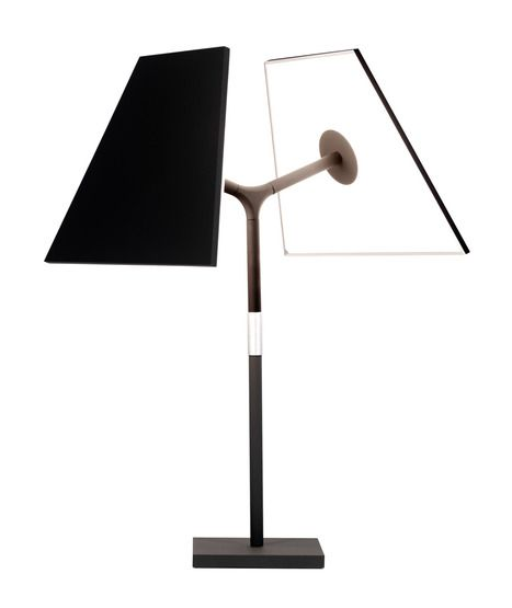 """Symtra Lamp by Peter Stathis - A lamp that consists of a """"bulb-less"""" archetypal lampshade with the primary light source being the shade itself. The lamp utilizes optical waveguide technology on its inner panels that casts warm, glare-free illumination over a broad surface. The lamp head also has a full 360° range of rotation. 