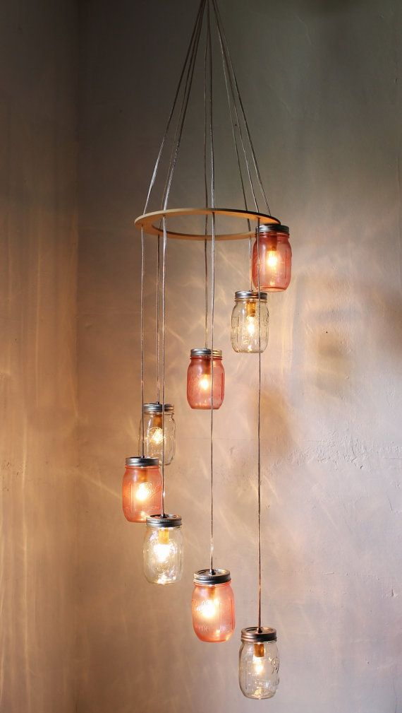 Bell Mason Jar chandelier #DIY - actually make it yourself with some electrical cords and DIY tinted mason jars.  Make sure to poke holes in the lids to release heat.