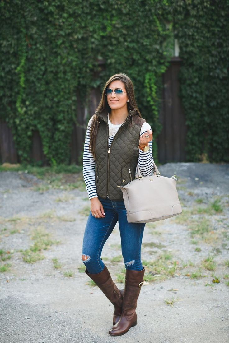 Navy and white striped tee+ripped skinny jeans+brown knie-high riding boots+khaki  quilted vest+ivory hand bag+sunglasses.
