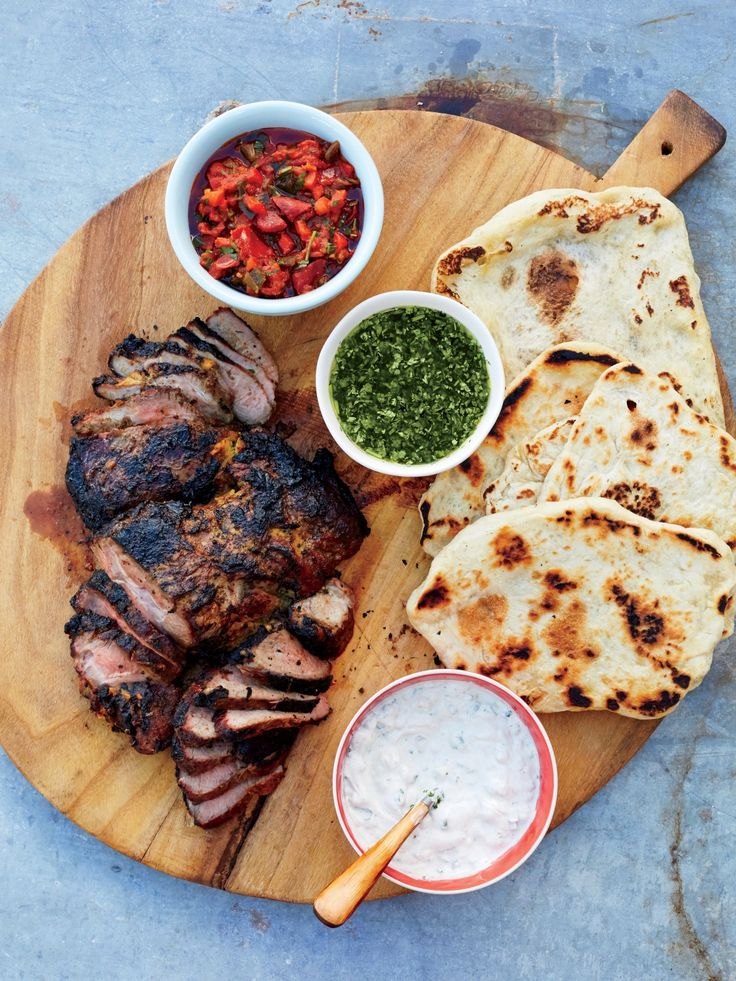 Grilled Lamb and Homemade Flatbreads | MyRecipes  If you grill over coals, choose natural hardwood charcoal, as Andrew Zimmern does, to infuse meat with smoky flavor. Serve with flatbreads.