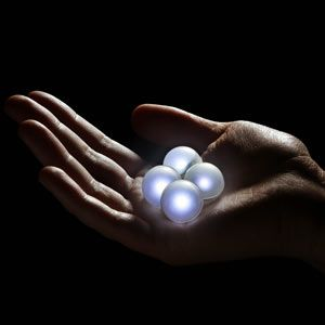 """Fairy Berries:  Each berry is about 3/4"""" in diameter and contains a tiny white LED that will glow and fade randomly, producing a fairy light effect. Toss 'em across your lawn for a twinkly landscape, string them up and hang them on trees, or float them in your pool or pond. Make some magic in your yard tonight!  Batteries are replaceable.  Pack of 10. $19.99"""