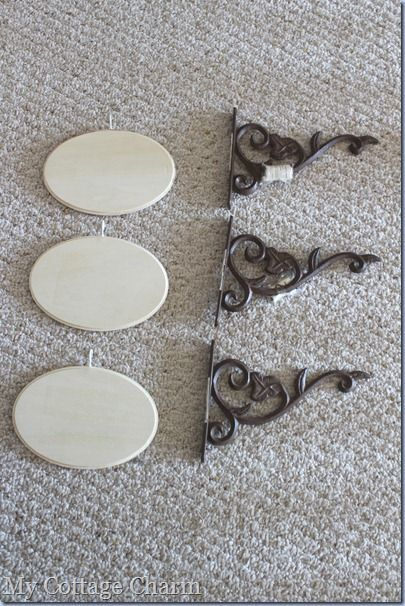 Hanging wood signs: Use plant hooks, small wood plaques, cup hooks and paint..