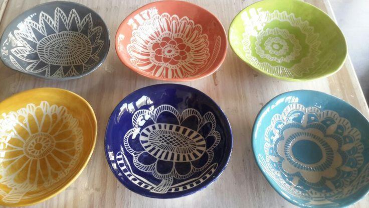 Six brightly coloured slightly wonki sgraffigo pudding  bowls