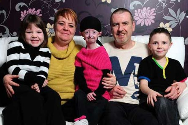 Courageous: Hayley Okines with her family