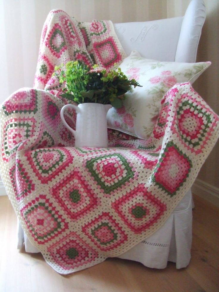 Granny squares blanket in pinks, greens and white