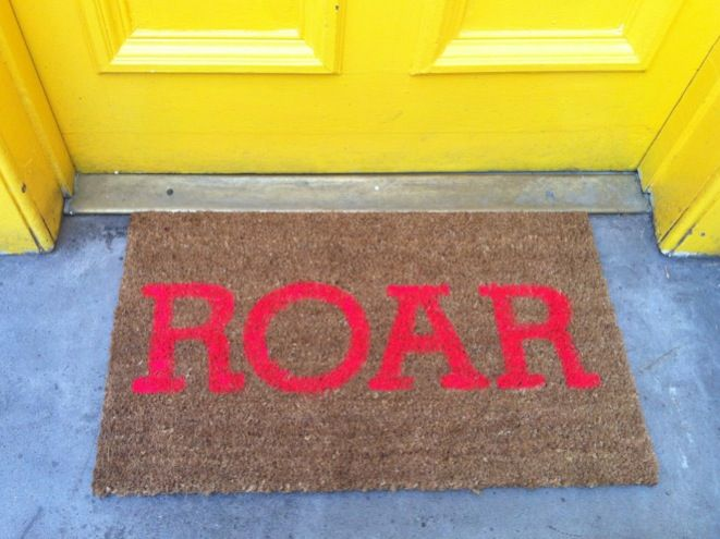 "Roar... super neon, super silly, darn cool doormat DIY. I bet ""customized"" doormats retail for something like $30... this probably cost at least half that to make and is even more customizable!"