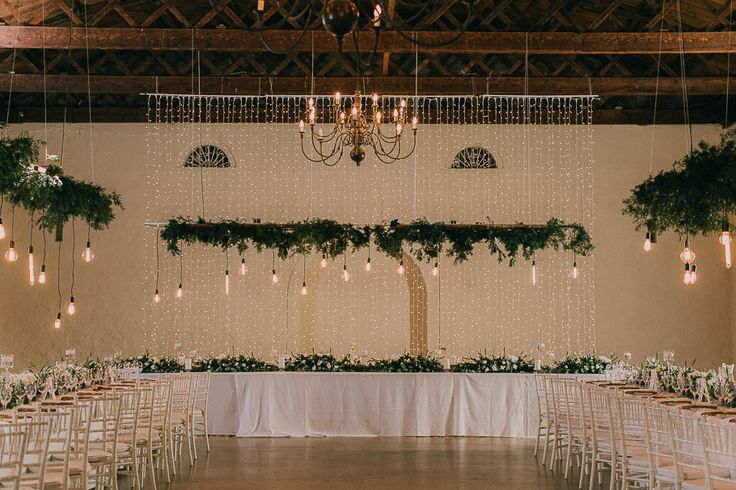 Nooitgedacht Wine Farm and Wedding Venue. Featured on my list of favourite wedding venues >> http://michelledt.com/wedding-venues-3/  Elegant wedding venue ideas. Decor inspiration with lots of hanging greenery installations and naked bulbs