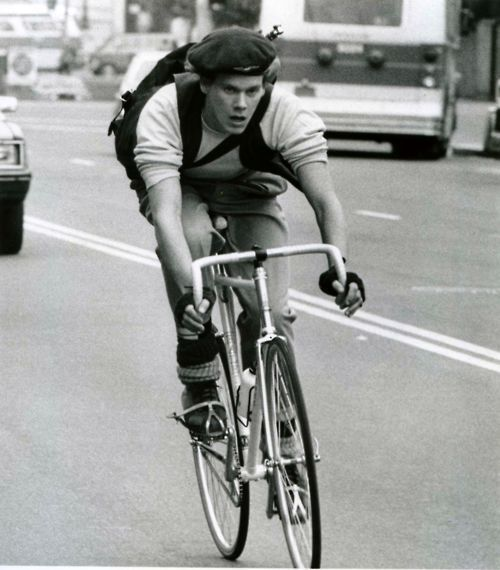 Kevin Bacon rides a bike.  Quicksilver Columbia Pictures 1986 Raleigh