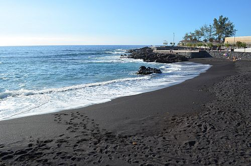 Here on Tenerife the natural beaches are of black volcanic sand. They look very different to the ones  in Britain where they are yellow sand, shingle, pebbles or rocks. The black sand looks very exotic and in many ways it is because Tenerife is one of the Canary Islands and off the coast of North Africa.The black sand is made from ground down basalt and other dark volcanic rocks and these islands are all formed from volcanoes.