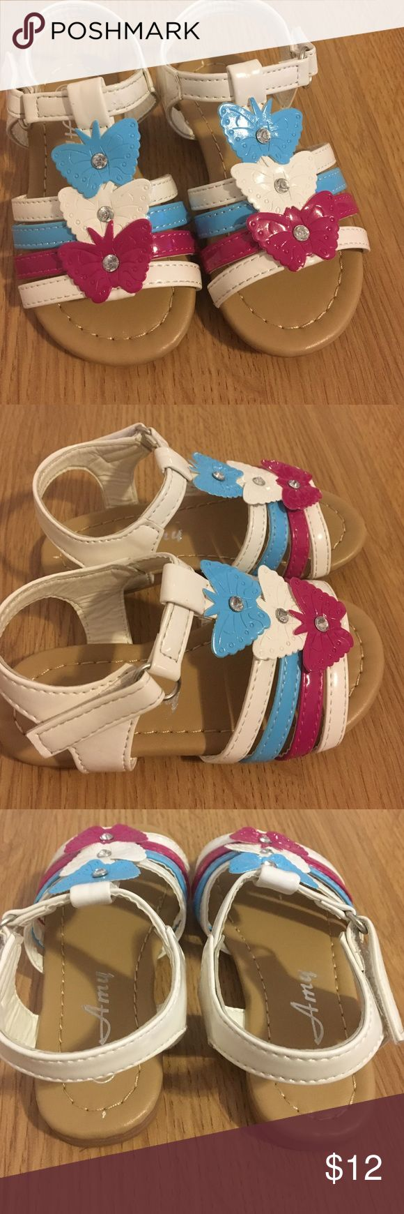 Blue pink white toddler size 6 sandals New blue, white, and pink sandals.  Has butterflies at the tops of the sandals.  Very cute. Size 6 toddler. Amy Coe Shoes Sandals & Flip Flops