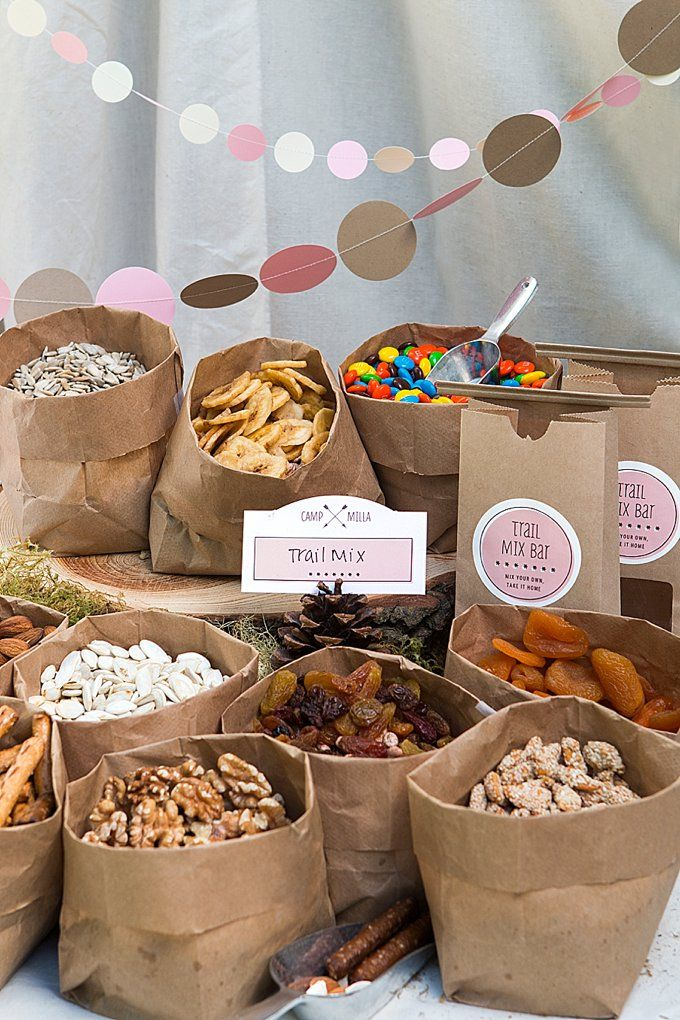 Camp-Themed Birthday Party for Kids! Great idea for trail mix, but this is also a beautiful way to display foods if you want a n elegant rustic look to a party. You could put your bowls of food in the folded down paper bags and you could wrap a lace ribbon around the bags!