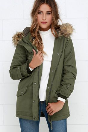 Mountain peaks to rooftop romping, any blustery day would be infinitely better snuggled in the Luck of the Draw Faux Fur Olive Green Parka Jacket! Woven cotton fabric in a classic olive green shade shapes a hooded jacket (with detachable faux fur trim) and long sleeves with ribbed cuffs. Long, straight-cut bodice is fastened with a hidden gunmetal zipper and cinched at the waist with a drawstring, while decorative flap pockets and functional patch pockets have gunmetal accents.