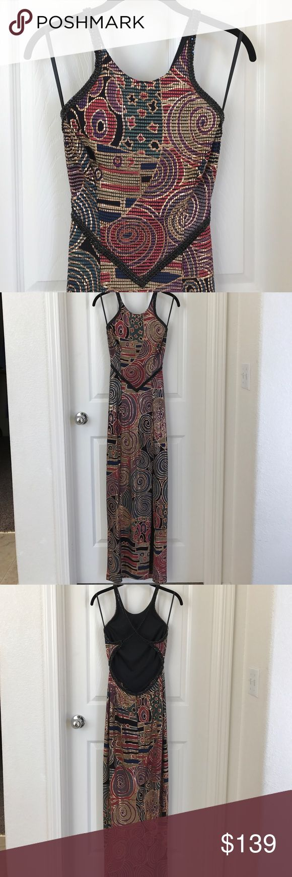 Vintage Janine Gown Vintage Janine evening gown. Fabric is print with gold metallic, and trimmed with black rhinestones. Front slit over the left knee. Label reads petite. Message for measurements. Excellent preowned condition. This dress is absolutely stunning. Janine Dresses Backless