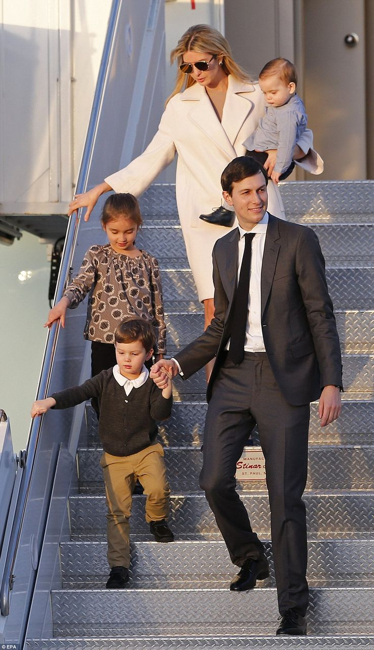 Family trip: Jared Kushner walks with his wife Ivanka and their children as they depart Air Force One in West Palm Beach, Florida