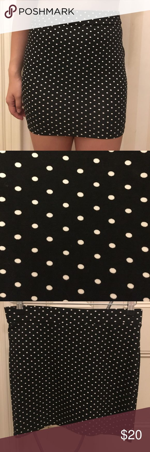 Black tube skirt with white poke-a-dots! Never worn black tube skirt with white poke-a-dots. Bought in the Netherlands. Store: The Sting/ Brand: Sutherland. Size S. 92% cotton and 8% spandex. Machine washable. Sutherland Skirts Pencil