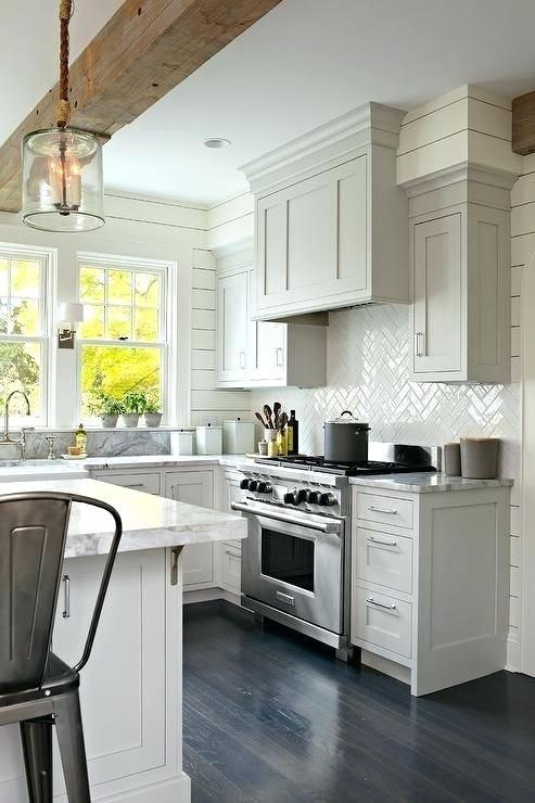Herringbone Backsplash Tile Stunning Transitional Kitchen Features A Stainless Steel Range Sat Against White Tiles Holding Gl