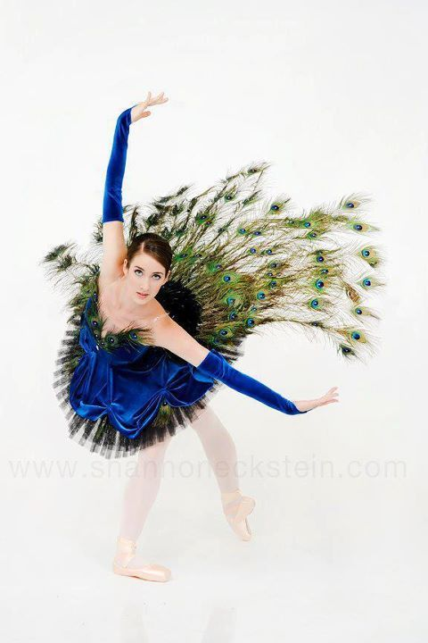 Only male peacocks have beautiful feathers , so perhaps a male dancer is more appropriate