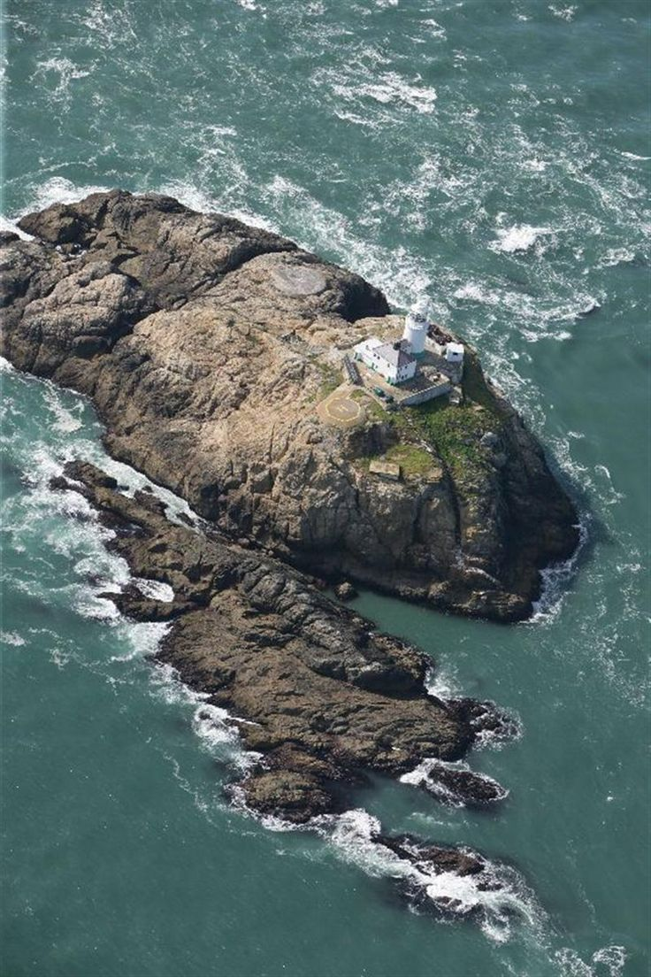 The South Bishop Lighthouse on South Bishop Island  also known as Emsger, a small rock approximately 5 miles west of St. Davids Head, Pembrokeshire, Wales, UK.  It was built on the island in 1839 and converted to electric in 1959, in 1971 a helipad was constructed at the site.  Finally, the lighthouse was automated and the keeper's left in 1983. it is monitored from the control centre at Trinity House in Harwich, Essex, England.