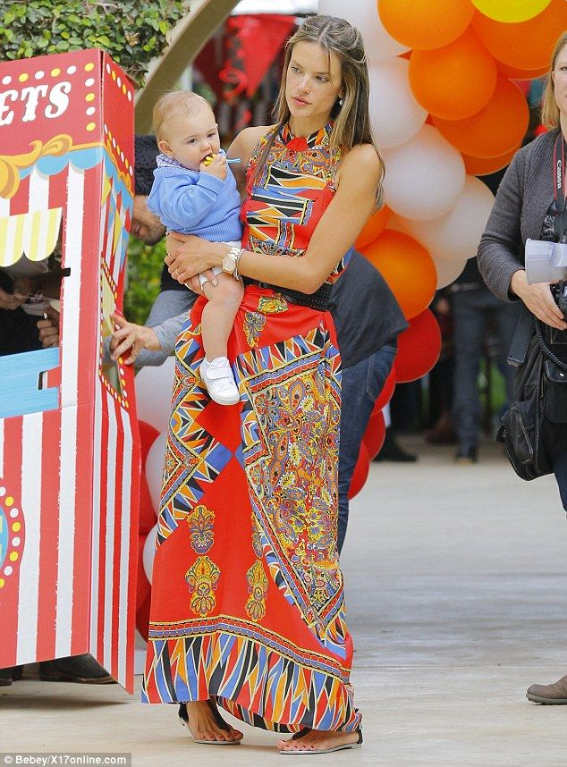 Model mum: The Victorias Secret model threw her son a big balloon-laden bash complete with cupcakes, lollipops, and a tiny ticket photo-booth