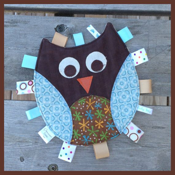 Owl Tag Toy for a baby boy with brown and blue  appliquéd features and ribbon tags backed with flannel