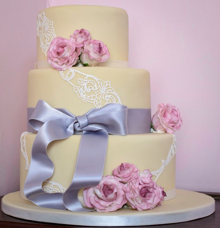 Roses & lace 3 tier cake. Hand sculpted and painted roses decorated with beautiful edible lace