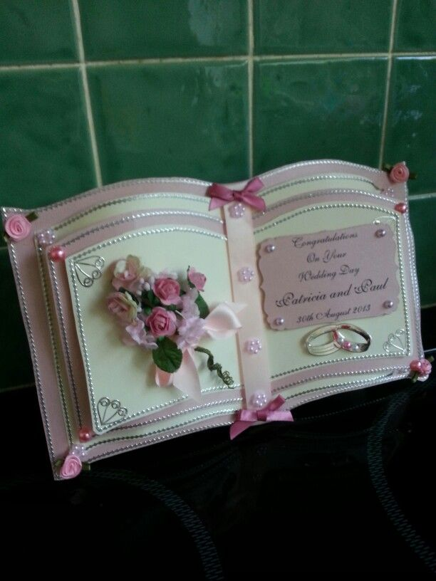 Pink & cream Bookatrix wedding card.