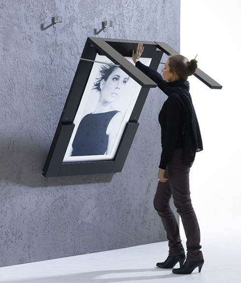 Folding table, doubles as a picture frame. Could be a cool DIY project, but can be purchased here. http://www.ivydesign.at/products/picture-table
