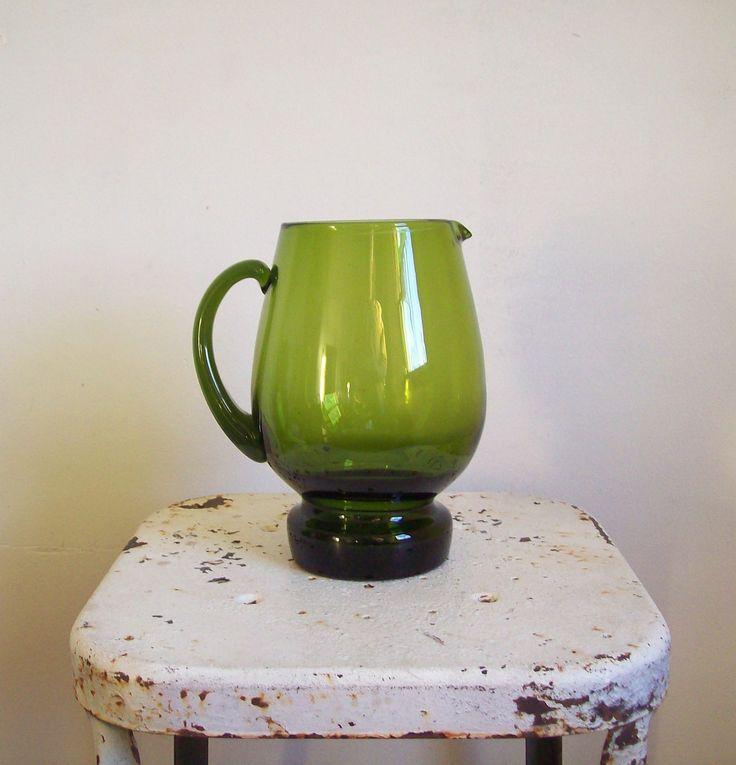 Vintage water pitcher deep green glass pitcher heavy bottom mid century Scandinavian glass by MattiesMenagerie on Etsy https://www.etsy.com/listing/255875141/vintage-water-pitcher-deep-green-glass