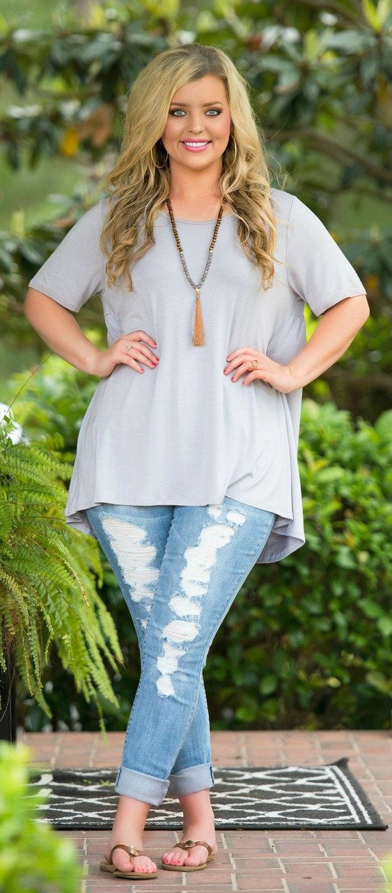 Cute and comfy looking outfit! Love the capris, long necklace, and gray! Love it…