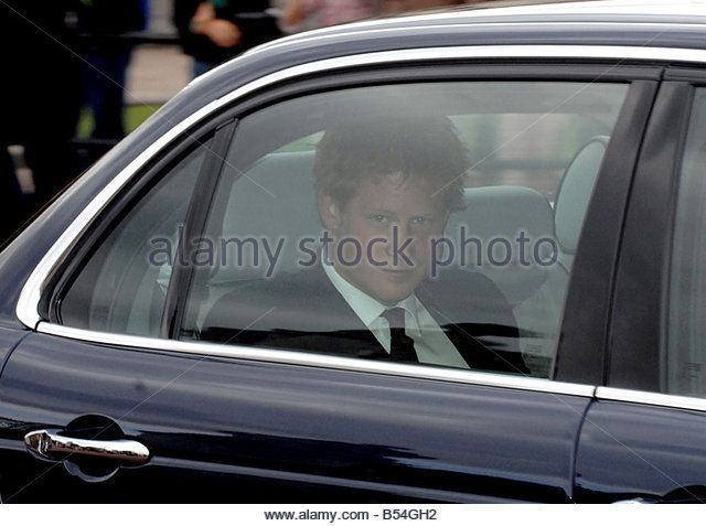 Prince Harry leaves a memorial service for his mother, Princess Diana, held at…