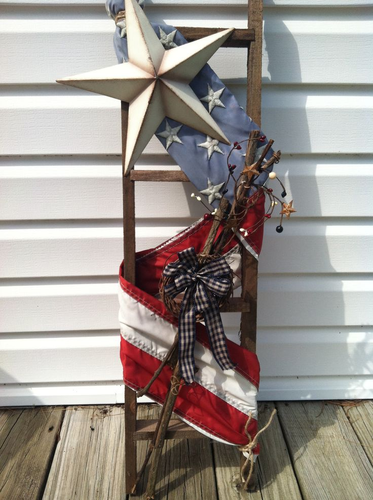Bought a small ladder at craft store and added my old flag and some other decorations.