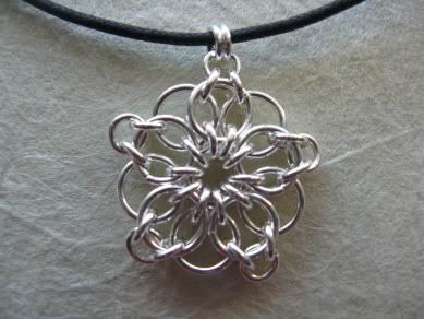 silver star/snowflake using jump rings. would be even prettier with beads added.