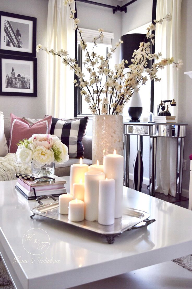 This mother pearl vase from HomeGoods looks great mixed in with all these  neutral colors. - 25+ Best Ideas About Coffee Table Decorations On Pinterest