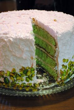 Pistachio Cake --the beautiful green color comes from pistachio Jell-O and ground pistachio nuts. A simple home made cake that includes a white chocolate buttercream frosting recipe.