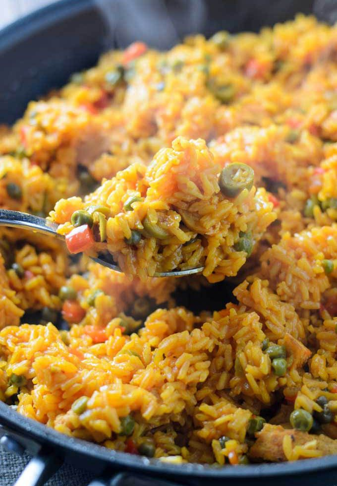 Easy Arroz Con Pollo is a Latin American chicken and rice dish with olives, capers, garlic, and Sazón with Azafrán.