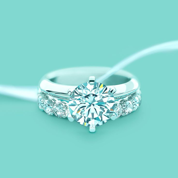 Trendy Diamond Rings :    The Tiffany® Setting engagement ring with a shared-setting diamond band ring. #TiffanyPinterest #WeddingBand  - #Rings https://youfashion.net/wedding/rings/diamond-rings-the-tiffany-setting-engagement-ring-with-a-shared-setting-diamond-band-ring/
