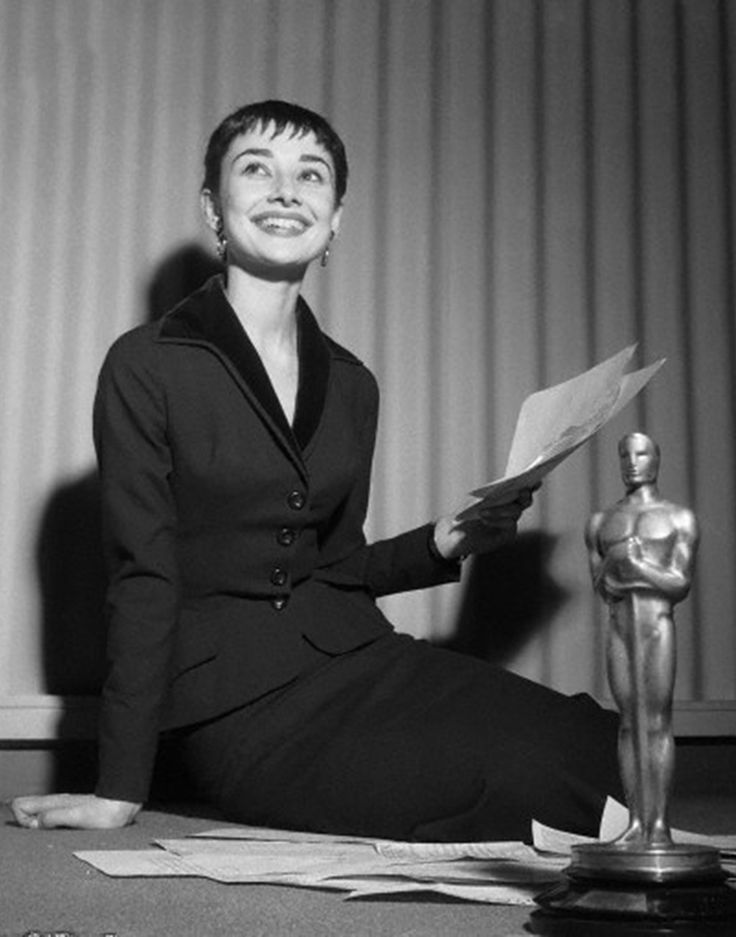 Audrey Hepburn photographed at a press conference the day after winning the Oscar for Roman Holiday, March 26, 1954.