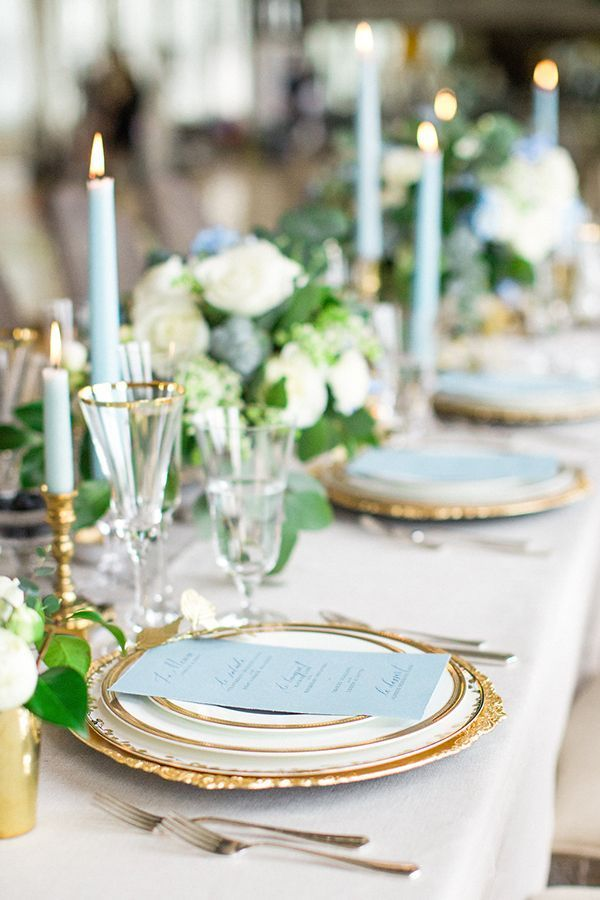 Elegant blue-and-gold tablescape | Photo by Deborah Zoe