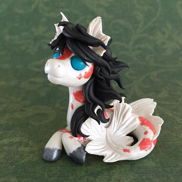 I loved making the koi dragon so much I made a koi Merpony too! I tried to make her hair look like it was flowing in water, I think she came out super cute! She'll be part of the etsy/eBay sale Sunday Aug. 20th @ 3pm MST. More pics shortly! #dragonsandbeasties #pony #merpony #hippocampus #waterpony #koi #fish #polymerclay #premo #sculpey