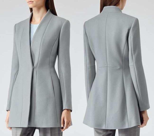 The grey jacket is from the brand's AW13 Collection and retailed for $520 before selling out.  It's a collarless, wool-rich coat with seam detail to the front, back and sleeves, with slit pockets to the front, and fastens with a single conceal button.