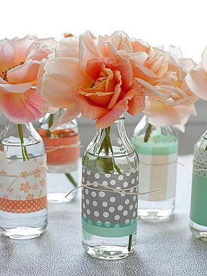 Scrapbook paper, an inexpensive buy at any craft store, turns a clear vase (or repurposed drink bottle) from blah to beautiful.