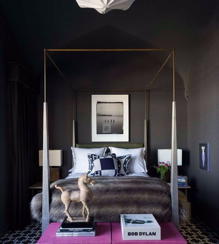 An eclectic master bedroom by Eric Cohler with a fur blanket and an exquisite canopy bed, also a pair of purple bedroom benches.
