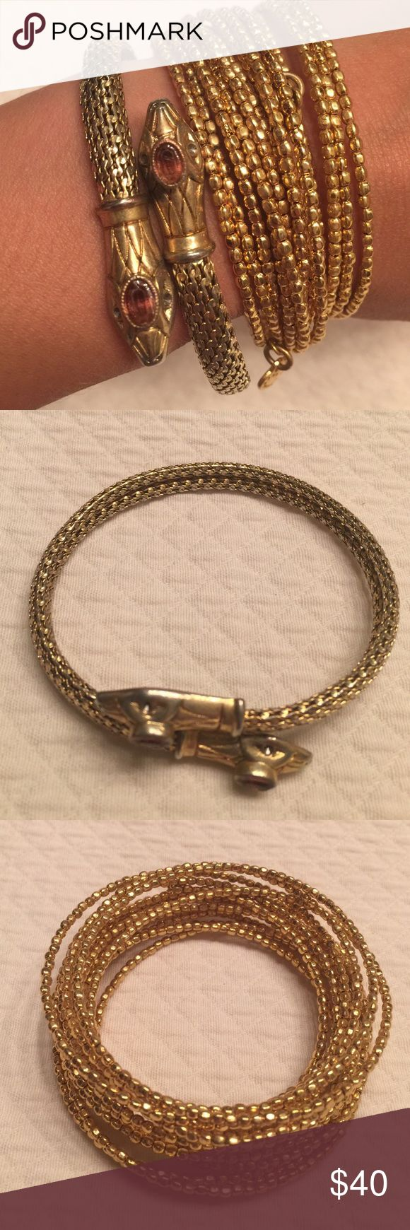 Stella and Dot bracelets Stella and Dot brackets in gold.  Perfect for layering.  Snake heads have a bit discoloration but hardly noticeable.  Priced accordingly, Stella & Dot Jewelry Bracelets
