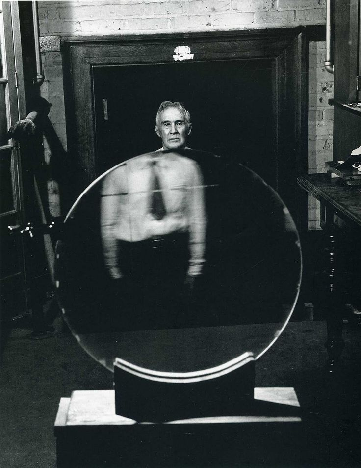 Andreas Feininger, Dr. Robert Wood Stands Behind a Mosaic Diffraction Grating, 1944
