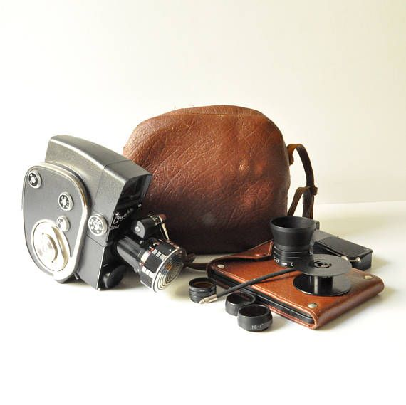 This is the amazing Quarz 700M Wind-Up / Clockwork Cine Camera made in USSR in its original carry case and box with 10 filters in an extra leather case.  The camera is well preserved as well as its case. It has storage space in the handle for 2 lenses. The clockwork movement works well but I havent tested the camera with film and it is being sold as is.  The camera runs well when wound but I havent tested it with film. In any case it is a fantastic addition to a collection, a great displ...