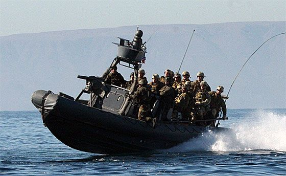 Marines with the 1st Marine Special Operations Battalion (MSOB) aboard a Rigid Hull Inflatable Boat (RHIB) during a boarding exercise.
