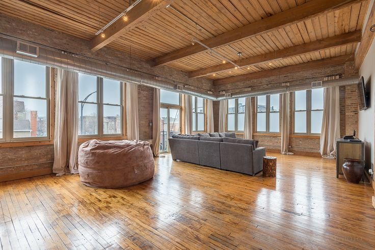 A spiral staircase leads to a rooftop deck with views of the city skyline at this brick and timber loft for rent on the Near West Side. #apartment #chicago #loft #brickandtimber #nearwestside