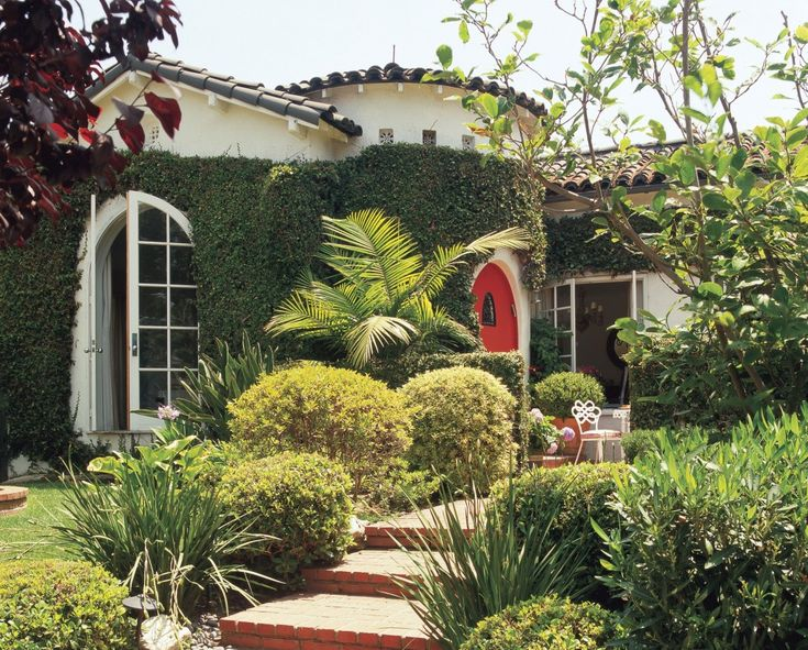 Abundant foliage covers the exterior of this quaint West Hollywood house.