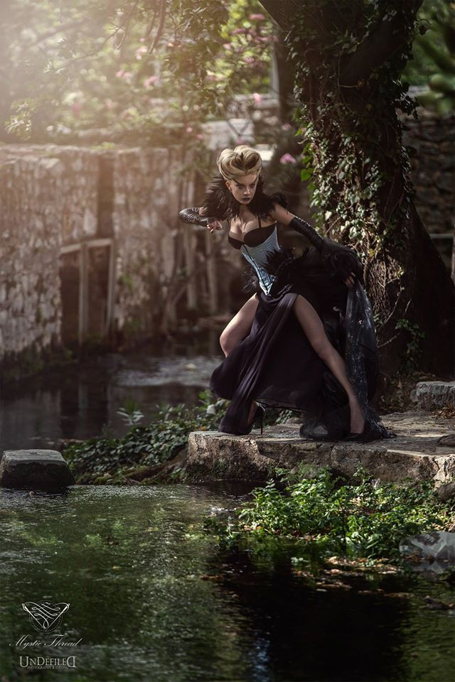 Neck corset, corset, shoulder pads, tail, dress & gloves by Mystic Thread / Model Φαιη Λαιμου /  Photo: Andy Van Rose / Clothes & Accessories: Mystic Thread-www.mysticthread.com / Edit: Undefiled Photography & Editing /  MUA: Christina Kollia MakeUp Artist /  Hair: Maria Mplatzouka Xanthopoulou #mysticthread #gothicshop #gothicaccessories #victorianaccessories #gothicclothes #victorianclothes #costume #corset #neckcorset #feathercorset #featherneckcorset #shoulderpads #gloves